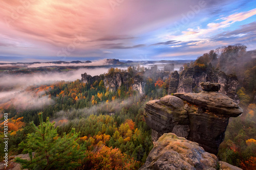 Photo sur Toile Brun profond Foggy sunrise in the Saxon Switzerland, Germany, view from the Bastei lookout point. The Bastei is a tourist attraction for over 200 years.