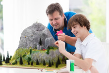 Father And Son Work On Model B...