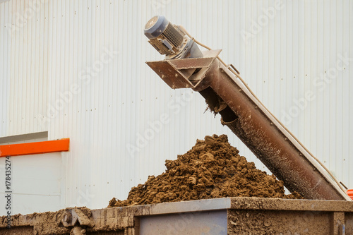 Removal of poultry manure from a poultry house Wallpaper Mural