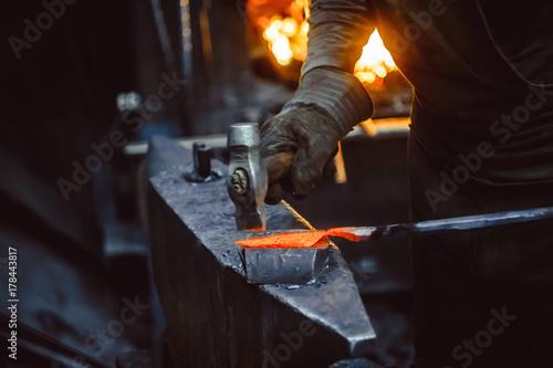 blacksmith working on an anvil Canvas Print