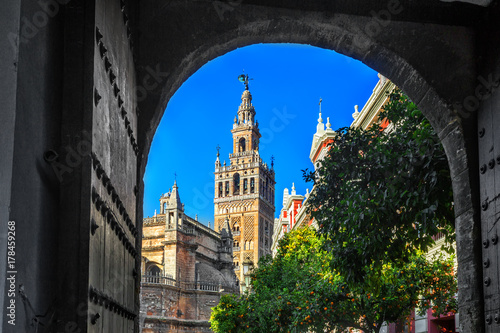 Beautiful Gothic building of the Cathedral of Saint Mary of the See (Seville Cathedral) on sunny day. Seville (Sevilla), Andalusia, Southern Spain.