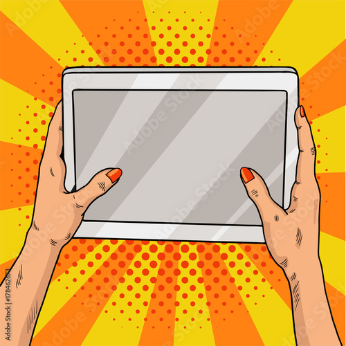 Hands holding a tablet pop art. Female hands with red manicure hold a laptop computer. Vintage pop art retro illustration.