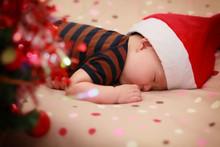 Sleeping Baby Wearing Santa Hat