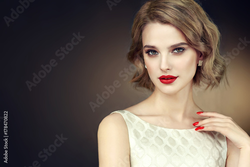 Valokuva  Beautiful model girl with short curly  hair and red lips