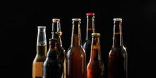 Set Of Beer Bottles On Black B...