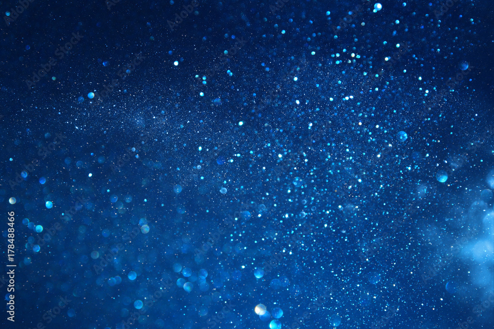 blue glitter vintage lights background. defocused
