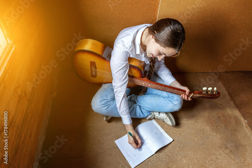 girl with a guitar who writes a song Wallpaper Mural