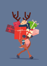 Elf Holding Gift Boxes Stack O...