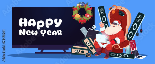 Happy New Year Banner With Santa Claus Sitting With Modern Electronics Gadgets And Plasma Tv On Background Vector Illustration Buy This Stock Vector And Explore Similar Vectors At Adobe Stock