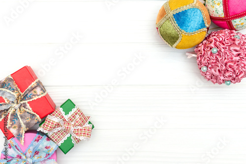 Fototapeta Gift boxes and New Year ornaments and toys on white wooden background obraz na płótnie