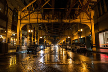 Night Empty American City Street With Parked Cars And Subway In Chicago At Rainy Day