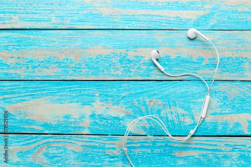 earphones on wooden table