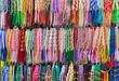 Colorful braided friendship bracelets on stand at market