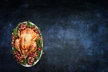 Roast Thanksgiving Day Or Christmas Turkey Over A Blank Chalkboard Or Blackboard With Room For Copy Space.