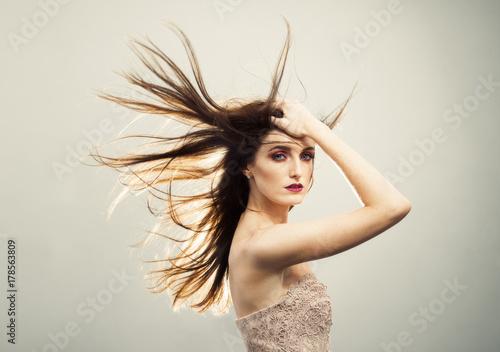 Fotografia, Obraz  Beautiful Young Woman With Windswept Hair