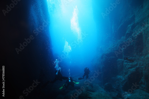 Underwater caves in the ocean with scuba divers