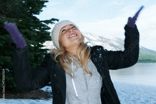 Portrait of young beautiful woman on winter outdoor background. Canvas Print