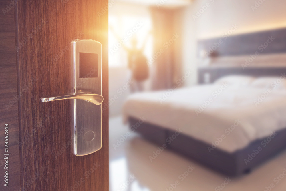 Fototapety, obrazy: Opened door of hotel room in morning with background blurred happy backpacker traveller stay in hotel, sunlight effect.