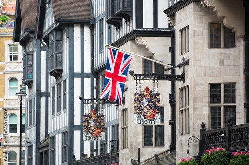 Photo  LONDON, UK - August 24, 2017: The  British flag and the Liberty coat of arms