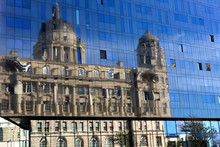 Reflection Of A Classic Building In A Modern Glass Wall