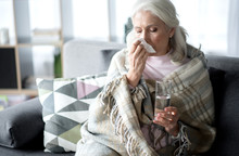 Senior Lady Suffering From Flu...