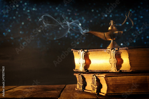 Photo  Image of magical aladdin lamp with glitter smoke. Lamp of wishes.