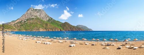 beach with umbrellas and sunbeds on the shores of the Mediterranean Sea in Turkey