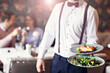 canvas print picture - Romantic couple dating in restaurant being served by waiter