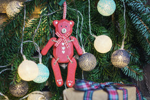Red Wooden Bear Hanging In Chr...