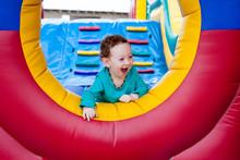 Happy Toddler Peeking On Tramp...