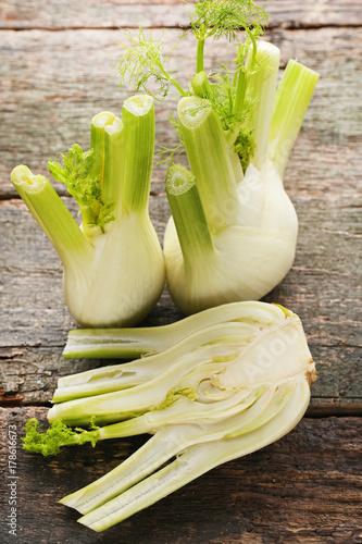 Ripe fennel bulbs on wooden table
