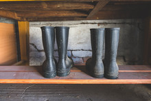 Old Dirty Farm Shoes, Rubber Boots, On A Shelf In A Storage Room, Vintage Look