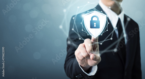 Fotografia  Businessman touching shield protect icon, Concept cyber security safe your data