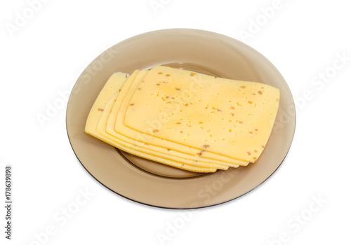 Fototapeta Pokrojony ser robić z zdruzgotanymi orzechami włoskimi na szklanym naczyniu