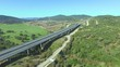 Aerial view of freeway sorrounded by green nature