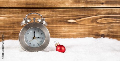Valokuva  clock with christmas ball for time change in winter