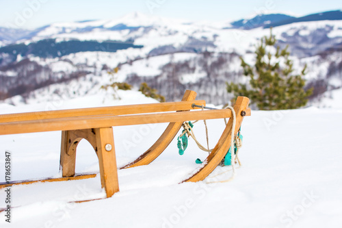 Obraz Wooden sleds on snow covered mountain - fototapety do salonu