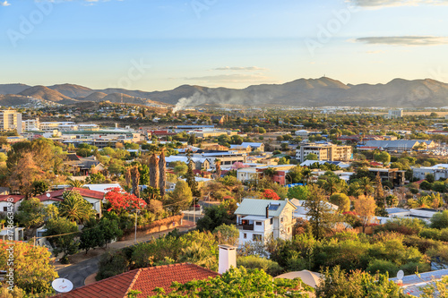 Fotografie, Obraz  Windhoek rich resedential area quarters on the hills with mountains in the backg