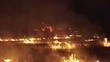 Military men training kicks at night bonfires. 4K