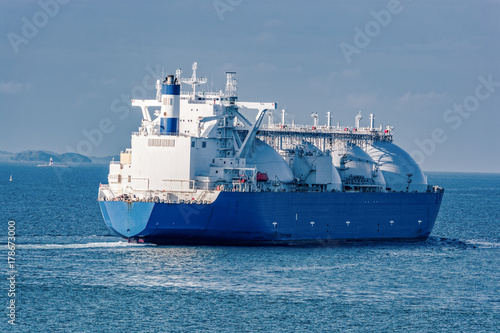 LNG tanker is passing by Singapore Strait.