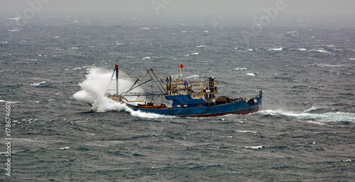 Fishing boat in rough weather
