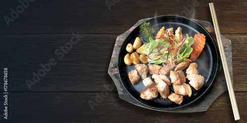 Authentic delicious Japanese food Fried Pork serve in the Hot Pan.
