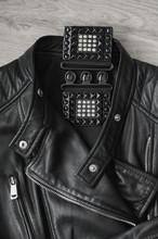 Black Women's Leather Jacket And Black Leather Belt.