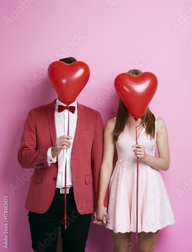 Fototapeta  Unrecognizable couple with balloon holding hands