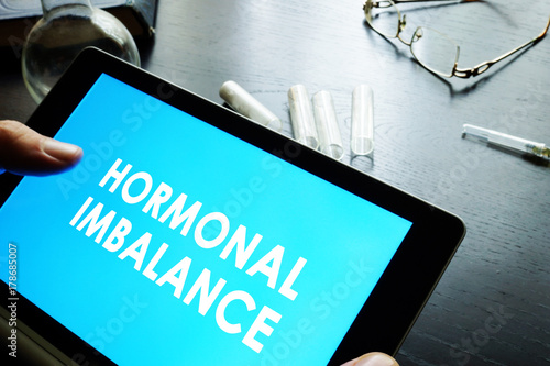 Fotografie, Tablou  Hormonal imbalance sign on a tablet.