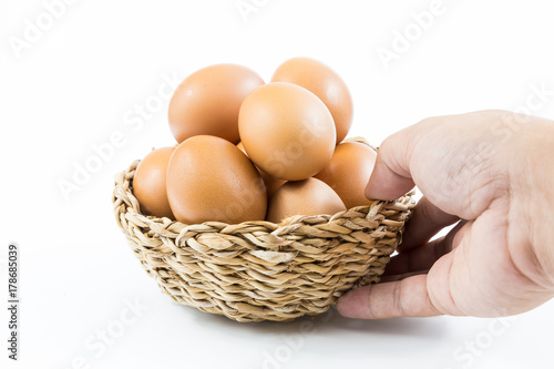 Eggs put in a basket of white background.