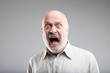 strong exaggerated fear expression of an old man
