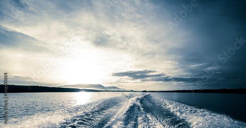 Motor boat water traces in open caribbean sea Fototapeta