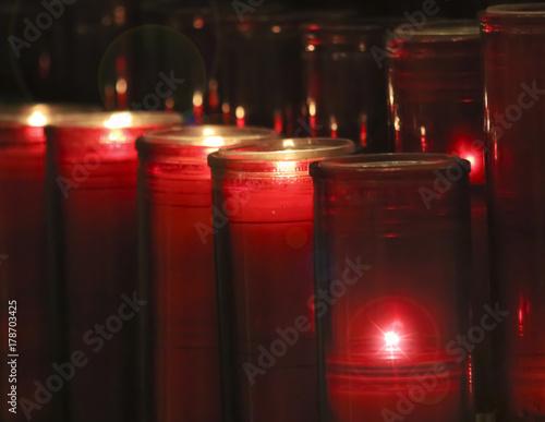 Fotografie, Obraz  An Arrangement of Prayer Candles in a Church