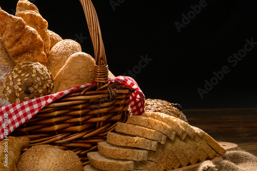 Fotografia, Obraz  Close up of Baked Bread with basket; Various fresh bread such as sesame bun, bag